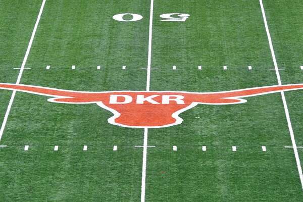 The initials of former Texas football coach Darrell K. Royal were painted inside the longhorn logo on the field at Darrell K. Royal-Memorial Stadium, Saturday, Nov. 10, 2012, in Austin, Texas. The initials were added in honor of Royal who passed away on Wednesday. (AP Photo/Michael Thomas)