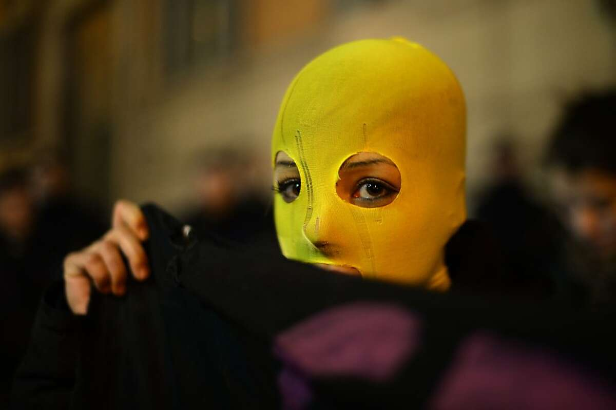 A protestor wears a yellow hood as she demonstrates against the prison sentences of the Russian band Pussy Riot, as well as shows support for human rights in Russia on November 25, 2013 near the Quirinale, the Italian President's residence, during a visit of Russia's President Vladimir Putin in Rome.