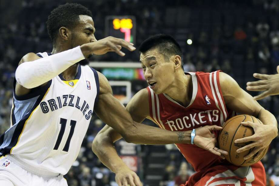 Jeremy Lin of the Rockets is defended by Grizzlies point guard Mike Conley. Photo: Danny Johnston, Associated Press