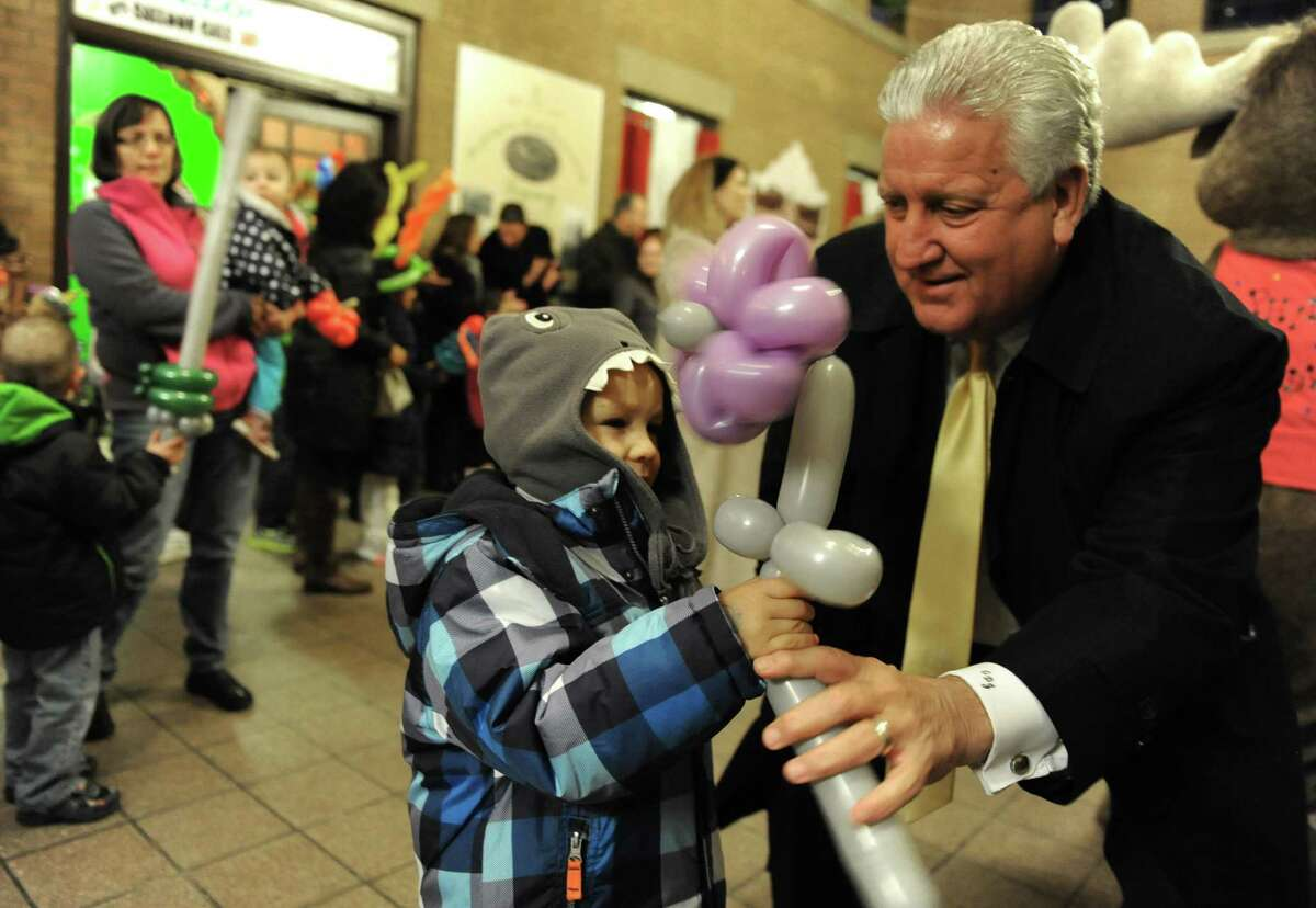 Mayor Jerry Jennings plays with Tyler Boenau, 4, of Latham before the lighting ceremony for the annual Price Chopper Holiday Lights in the Park at Washington Park on Monday, Nov. 25, 2013 in Albany, N.Y. Proceeds of this event benefit the Police Athletic League. (Lori Van Buren / Times Union)