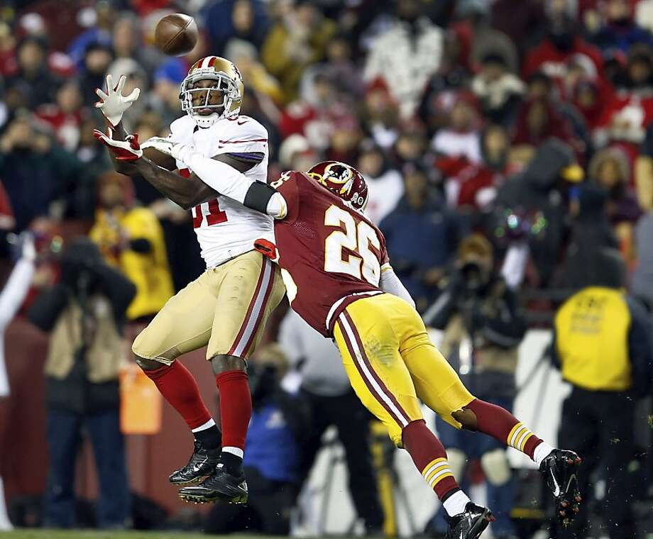 Anquan Boldin, who caught two touchdown passes and had 94 receiving yards, hauls in a second-half throw from Colin Kaepernick with Josh Wilson defending. Photo: Evan Vucci, Associated Press