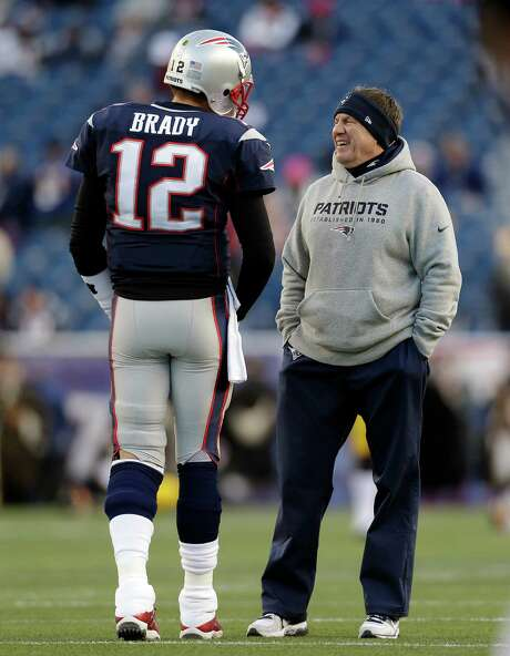 It shapes up as another laugher against the Texans for Tom Brady, left, and Bill Belichick on Sunday. Photo: Steven Senne, STF / AP