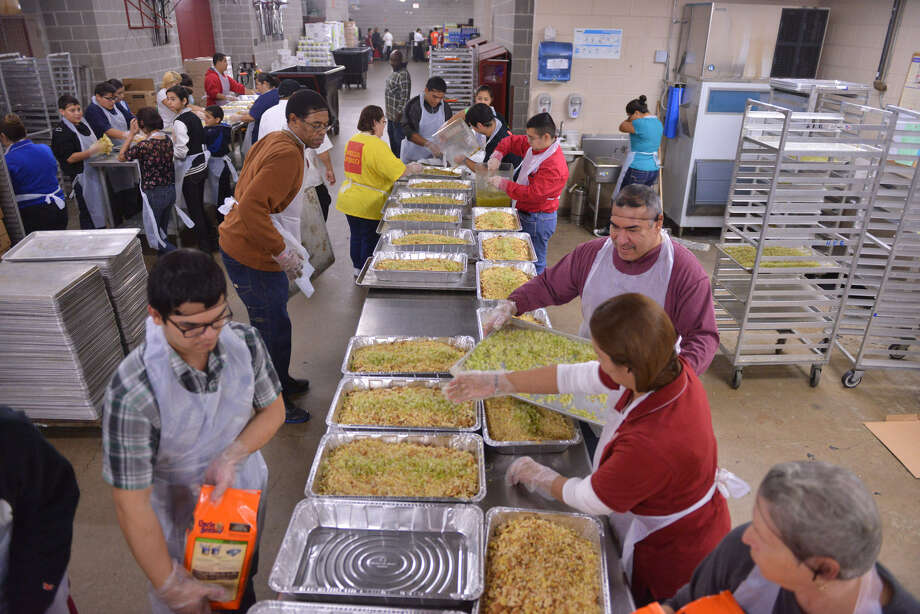 Volunteers prepare dressing for the Raul Jimenez Thanksgiving Dinner Monday, Nov. 25, 2013. The total number expected to work on the dinner is estimated at 4,000.