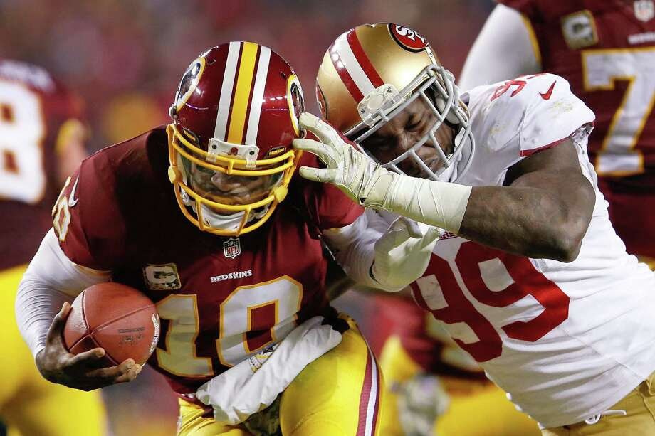 Washington Redskins quarterback Robert Griffin III is sacked by San Francisco 49ers outside linebacker Aldon Smith during the second half of an NFL football game in Landover, Md., Monday, Nov. 25, 2013. (AP Photo/Evan Vucci) Photo: Evan Vucci, Associated Press / AP