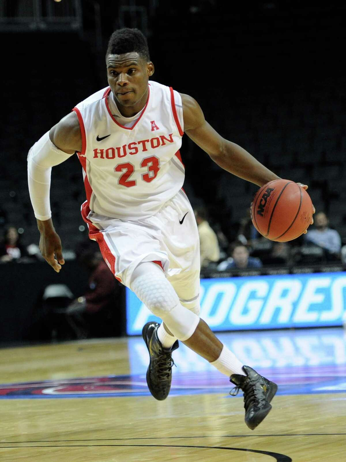 NEW YORK, NY - NOVEMBER 25: Danuel House #23 of the Houston Cougars carries the ball downcourt against the Stanford Cardinals during the second half at Barclays Center on November 25, 2013 in the Brooklyn borough of New York City.