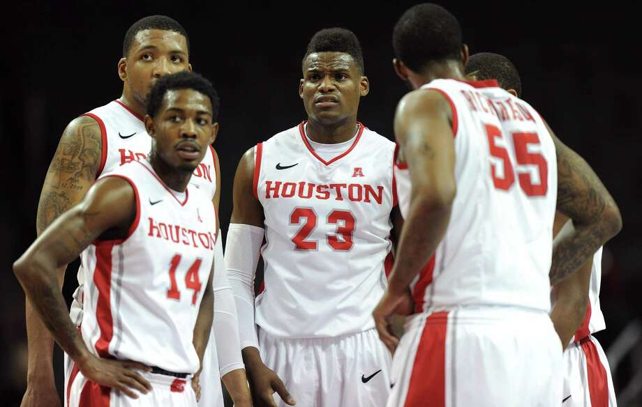 NEW YORK, NY - NOVEMBER 25: Danuel House #23; Tione Womack #14; and J.J. Richardson #55 of the Houston Cougars huddle together during the first half against the Stanford Cardinal at Barclays Center on November 25, 2013 in the Brooklyn borough of New York City. Photo: Maddie Meyer, Getty Images / 2013 Getty Images