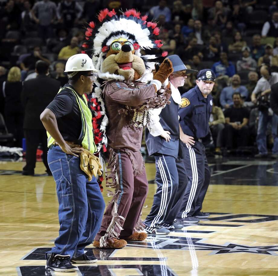 The San Antonio Spurs Coyote and others perform during the game with the New Orleans Pelicans Monday, Nov. 25, 2013 at the AT&T Center. The Spurs won 112-93. Photo: Edward A. Ornelas, San Antonio Express-News