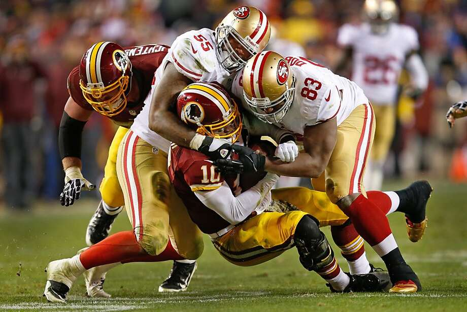 Linebacker Ahmad Brooks (55) gets in on a sack of Robert Griffin III with Demarcus Dobbs. Photo: Evan Vucci, Associated Press