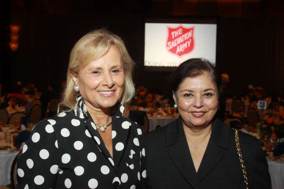 Souad Nassar, left, and Carolyn Musslewhite at the Salvation Army luncheon. Photo: Gary Fountain, For The Chronicle