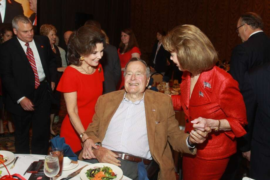 Linda McReynolds, from left, President George H. W. Bush and Jeanie Kilroy Wilson at the Salvation Army luncheon. Photo: Gary Fountain, For The Chronicle