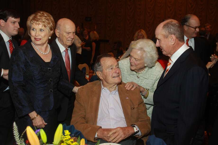 Ginger and Jack Blanton, from left, President George H. W. Bush, Barbara Bush and Eddy Blanton at the Salvation Army luncheon. Photo: Gary Fountain, For The Chronicle