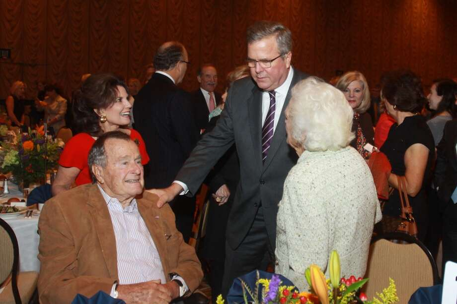 Linda McReynolds, from left, President George H.W. Bush, Jeb Bush and Barbara Bush at the Salvation Army luncheon. Photo: Gary Fountain, For The Chronicle