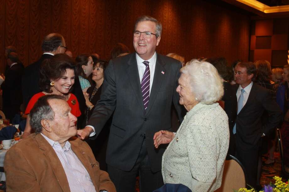 President George H.W. Bush, from left, Linda McReynolds, Jeb Bush and Barbara Bush at the Salvation Army luncheon. Photo: Gary Fountain, For The Chronicle