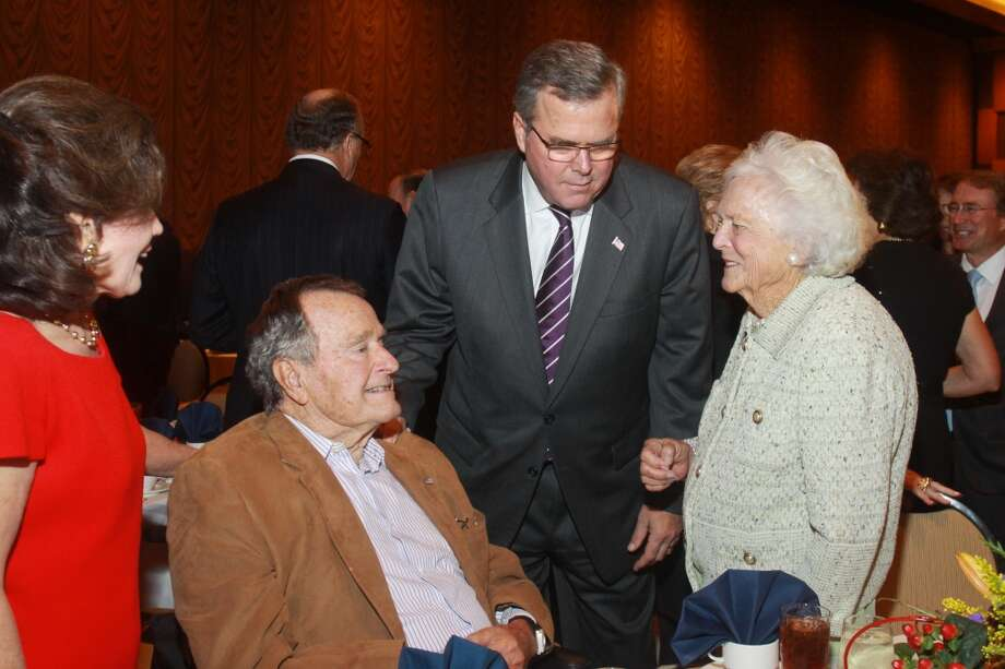 Former President George H.W. Bush, Jeb Bush and Barbara Bush attend a Salvation Army luncheon in 2013. Photo: Gary Fountain, For The Chronicle