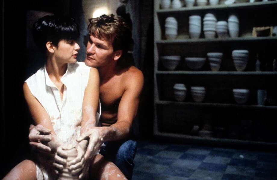 """""""Ghost"""" sequel:Creepy! Patrick Swayze just keeps coming back! He's a dark angel now or a poltergeist and repents ever trying to help his ex-lover recover. He's jealous and mean. Might make a good horror story. Or, he just hangs out trying to help all the time … like some pathetic ex-boyfriend who just hasn't gotten the message ... sitting bedside, invisibly weeping as she conceives her first born ... Photo: Demi Moore is embraced by Patrick Swayze in a scene from the film 'Ghost', 1990. Photo: Archive Photos, Getty Images / 2012 Getty Images"""