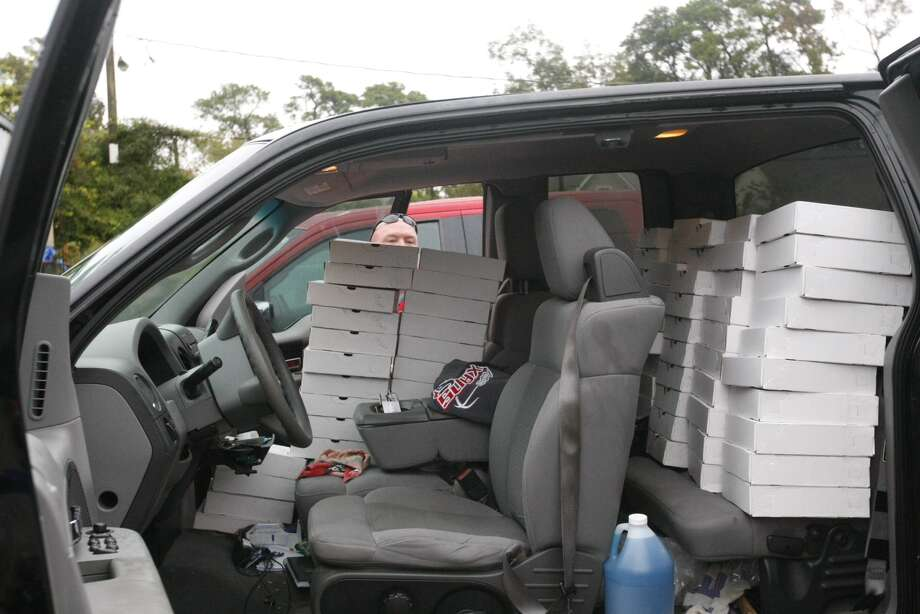 Jeff Qualls looks over the top of a stack of pies stacked in his truck at Flying Saucer Pie Co. Qualls bought 90 pies. 