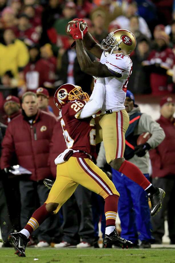 Wide receiver Anquan Boldin #81 of the San Francisco 49ers goes up for a catch against cornerback Josh Wilson in the first quarter at FedExField on November 25, 2013 in Landover, Maryland. Photo: Rob Carr, Getty Images / 2013 Getty Images