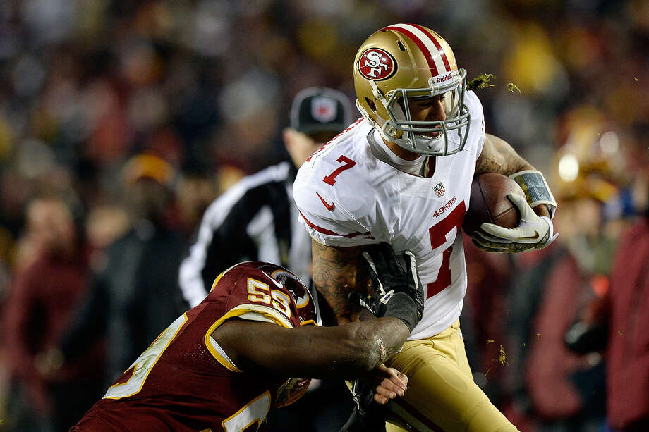 Colin Kaepernick of the San Francisco 49ers is tackled by London Fletcher as he scrambles with the ball in the second half of an NFL game at FedExField on November 25, 2013 in Landover, Maryland. Photo: Patrick McDermott, Getty Images / 2013 Getty Images