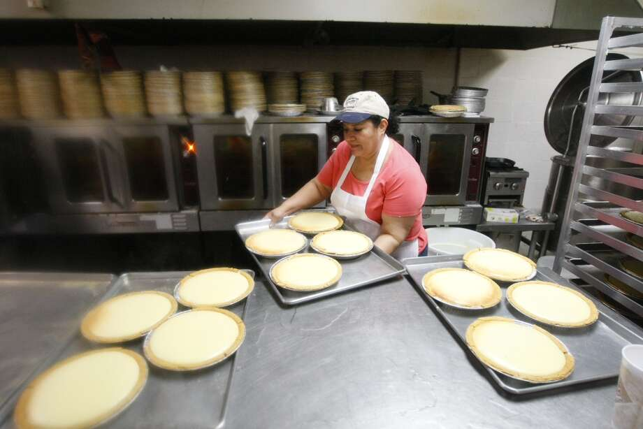 Lilia Medellin prepares pies at the Flying Saucer Pie Co., Tuesday, Nov. 26, 2013. Photo: Cody Duty, Houston Chronicle