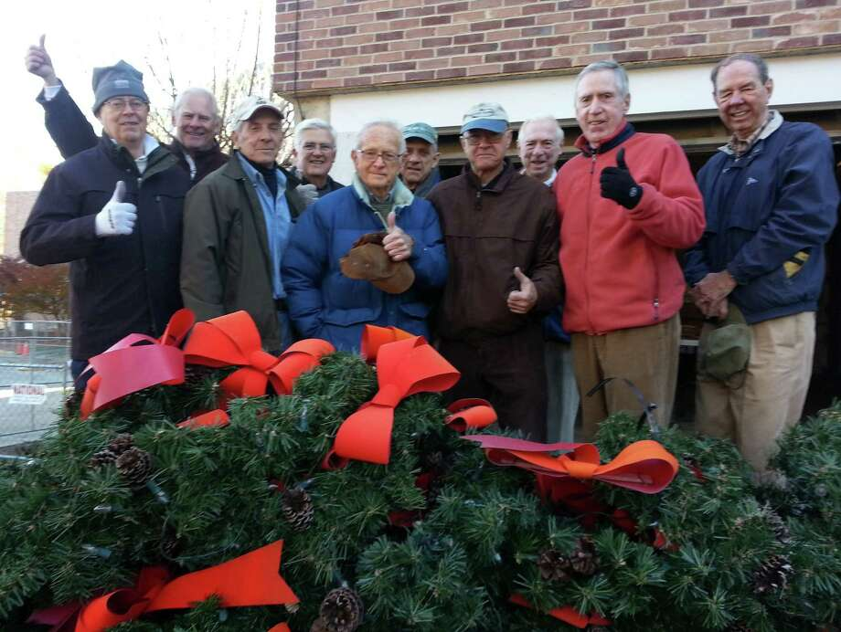 Members of the Darien Men's Association provided a lot of volunteer hours helping to decorate the town with holiday lights. From left, Marc Thorne, Alex Garnett, Bob Baker Jack Fitzgibbons, Taylor Strubinger,  Pete Kenyon, Steve Graveraux, Tom Gildersleeve,  Kevin Monahan and Tom Taylor. Photo: Contributed Photo, Contributed / Darien News