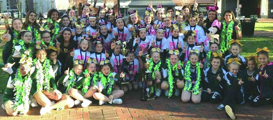 Three age levels of New Milford Bulls' Pop Warner cheerleading will represent their program and town Dec. 7 in national competition at Disney World in Orlando, Fla. November 2013.  Courtesy of Kristina Martinelli Photo: Contributed Photo / The News-Times Contributed