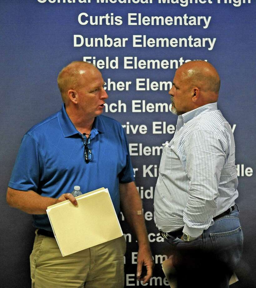After a 5-2 split while voting for the renting of voting machines and hiring an election administrator, BISD board members, Mike Neil, left, and Tom Neild, right, talk briefly after the BISD meeting on Wednesday, September 4, 2013. Photo taken: Randy Edwards/The Enterprise Photo: Randy Edwards, Photojournalist / Enterprise