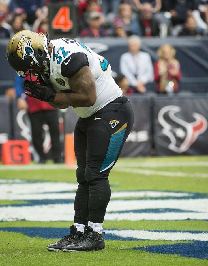 Jaguars running back Maurice Jones-Drew (32) imitates Arian Foster's touchdown celebration after scoring on a 1-yard touchdown run. Photo: Smiley N. Pool, Houston Chronicle