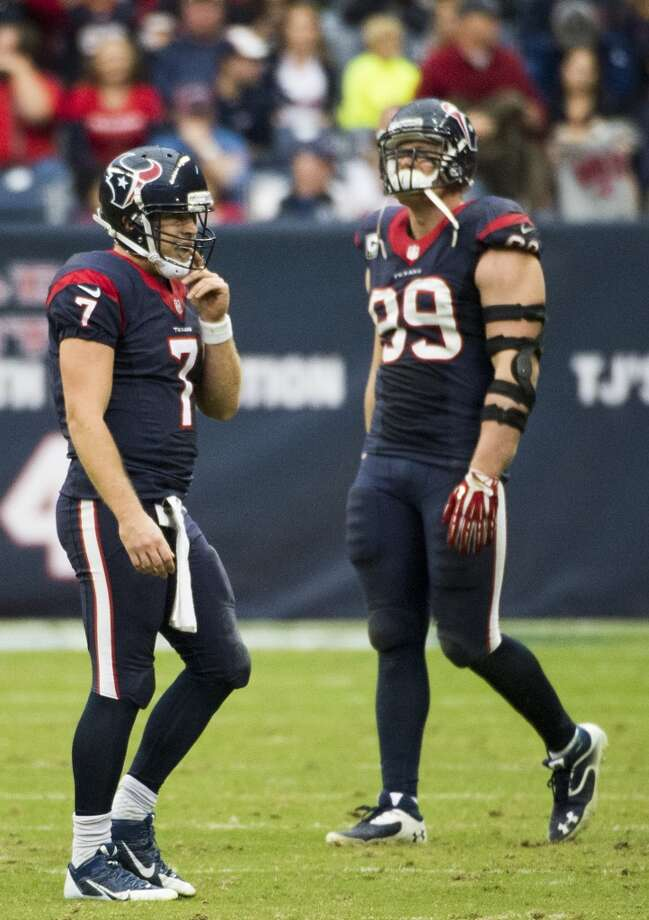 Texans quarterback Case Keenum (7) walks off the field as defensive end J.J. Watt (99) walks on after Jaguars defensive end Ryan Davis intercepts a pass with 45 seconds left. Photo: Smiley N. Pool, Houston Chronicle