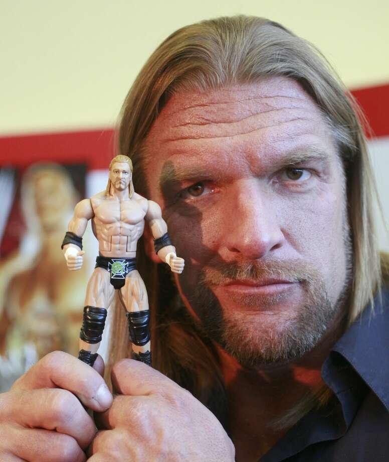 Boys No. 4:WWE action figures Photo: Mark Lennihan, AP