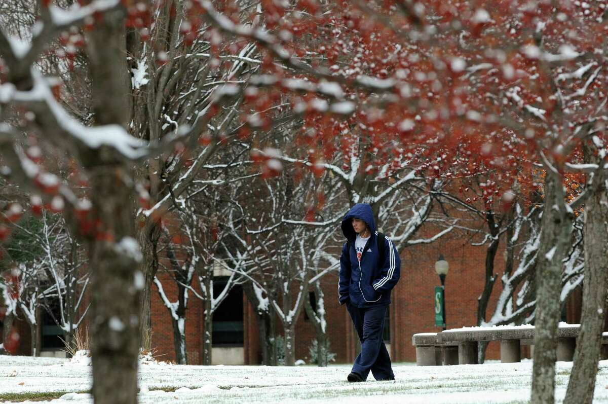Freshman Danny Li, 18, walks through a snow-covered campus on Tuesday, Nov. 26, 2013, at Siena College in Loudonville, N.Y. (Cindy Schultz / Times Union)