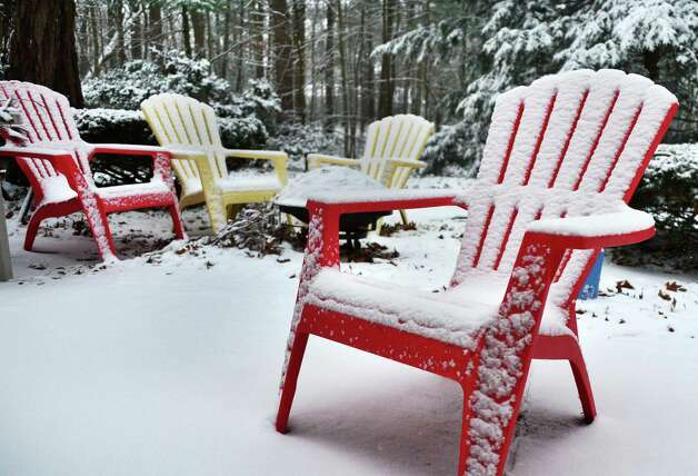 Snow dusts lawn furniture Tuesday morning Nov. 26, 2013, in Clifton Park, NY.  (John Carl D'Annibale / Times Union) Photo: John Carl D'Annibale / 00024809A