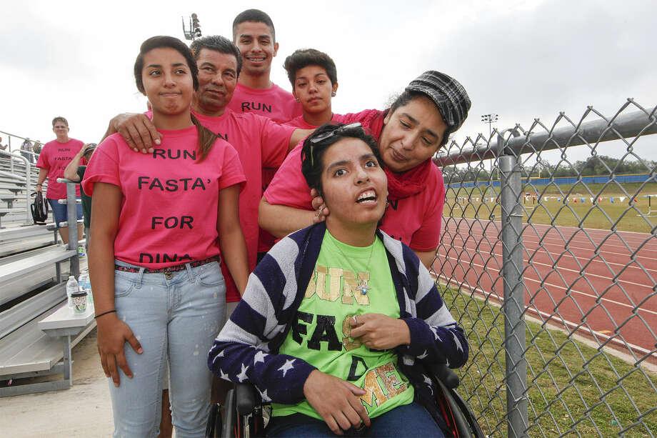 Dina Romero (17, front) poses with her family, Araceli Sanchez (from left), Armando Sanchez, Abram Sanchez, Daisy Sanchez and her mother Rosalia Sanchez, during the District 27-5A cross-country meet at Brandeis High School.