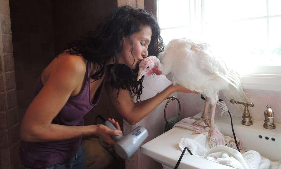 Karen Dawn gives Anne Turkey a kiss. Photo: Matt Washil, Courtesy Karen Dawn