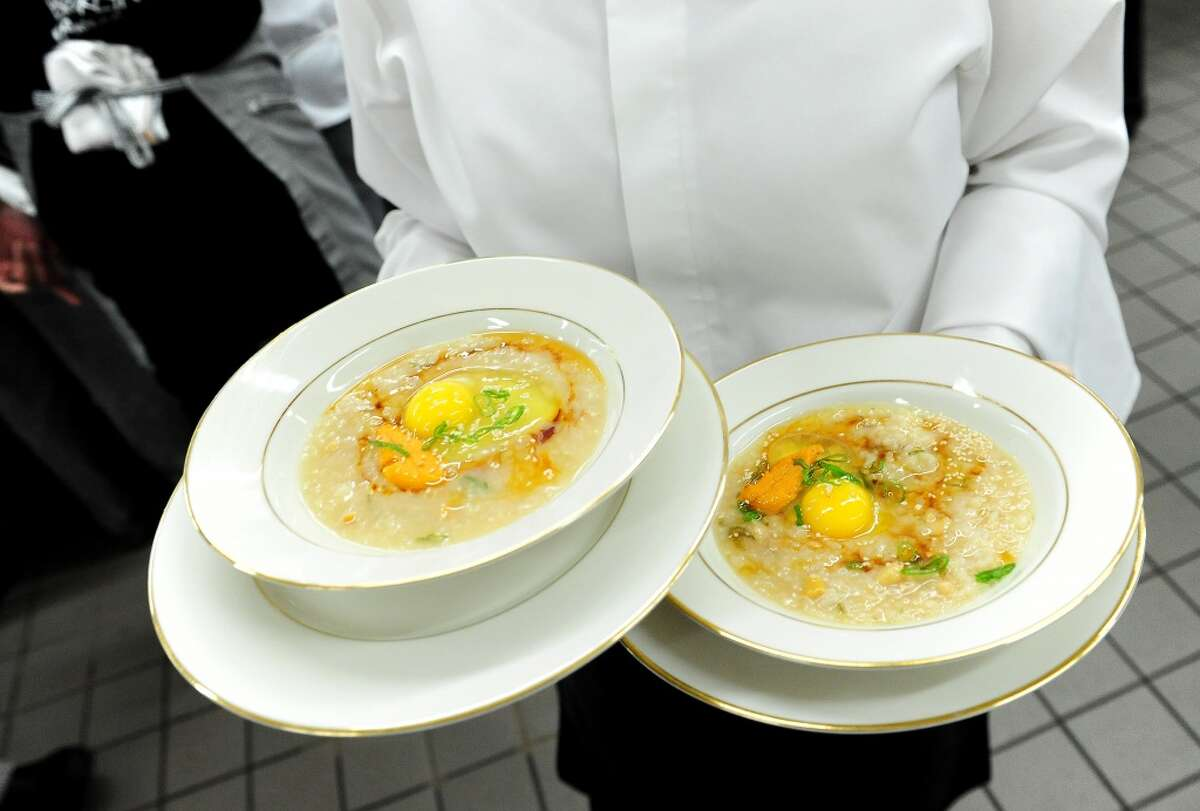 Abolone porridge with wild uni prepared by Chef Roy Choi is served during the welcome dinner for Flavor! Napa Valley held at the Silverado Resort and Spa in Napa on November 21, 2013.