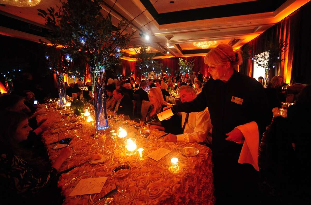 Linda Parker pours wine during the welcome dinner for Flavor! Napa Valley held at the Silverado Resort and Spa in Napa on November 21, 2013.