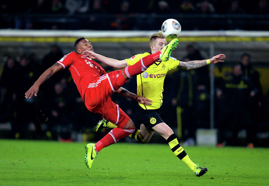 SoccerJerome Boateng of Munich controls the ball challenged by Marco Reus of Dortmund during the Bundesliga match between Borussia Dortmund and FC Bayern Muenchen at Signal Iduna Park on November 23, 2013 in Dortmund, Germany. Photo: Lars Baron, Bongarts/Getty Images / 2013 Getty Images