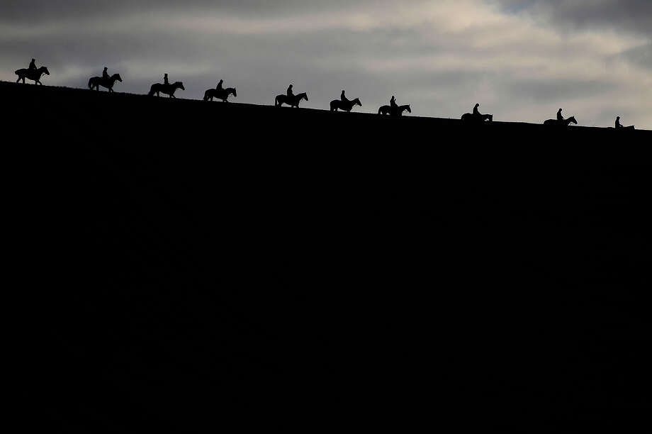 English people riding horsesHorses make their way down the gallops at Seven Barrows Stables on November 26, 2013 in Lambourn, England. Photo: Alan Crowhurst, Getty Images / 2013 Getty Images