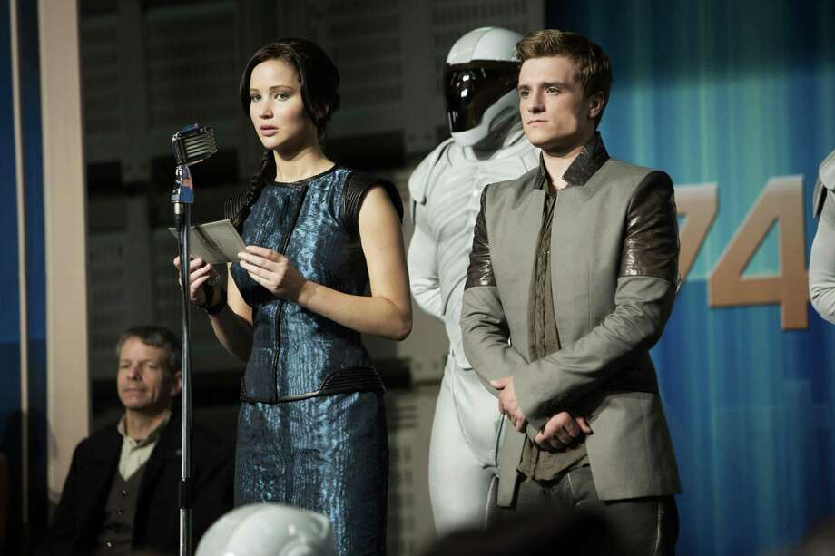 "Jennifer Lawrence stars as Katniss Everdeen and Josh Hutcherson as Peeta Mellark in ""The Hunger Games: Catching Fire."" Photo: Murray Close, HONS / Lionsgate"