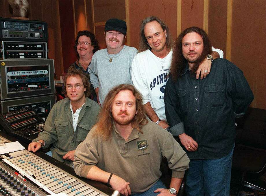 ** FILE ** Lynyrd Skynyrd's Muscle Shoals recording sessions brought together, clockwise from rear left, Billy Powell on keyboards, Hughie Thomasson, Rickey Medlocke, Gary Rossington on guitars, Johnny Van Zant on lead vocals and engineer Ben Fowler, in this Feb. 11, 1997 file photo. Not pictured are drummer Owen Hale and bassist Leon Wilkeson. The band is scheduled to perform Aug. 28, 2002, at the 2002 New York State Fair in Syracuse, N.Y.  (AP Photo/Times Daily, File) Photo: MATT MCKEAN, MBR / TIMES DAILY