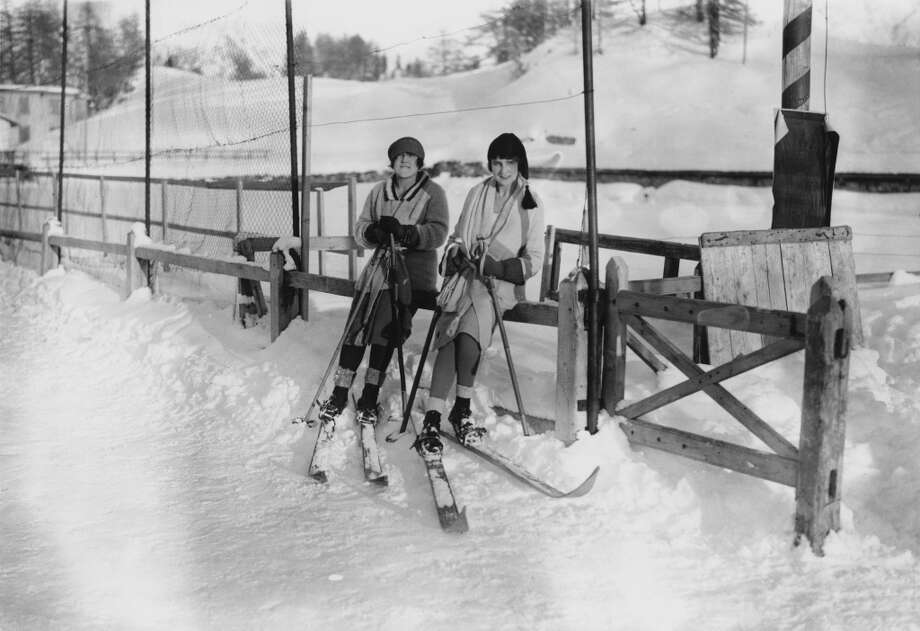 1921: Miss Nancy Fletcher and Mrs Eric Gamage on the ski slopes at St Moritz, Switzerland. Photo: W. G. Phillips, Getty Images