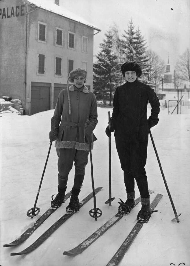 1925:  Women at Chamonix wearing the latest ski-wear. Photo: Seeberger Freres, Getty Images