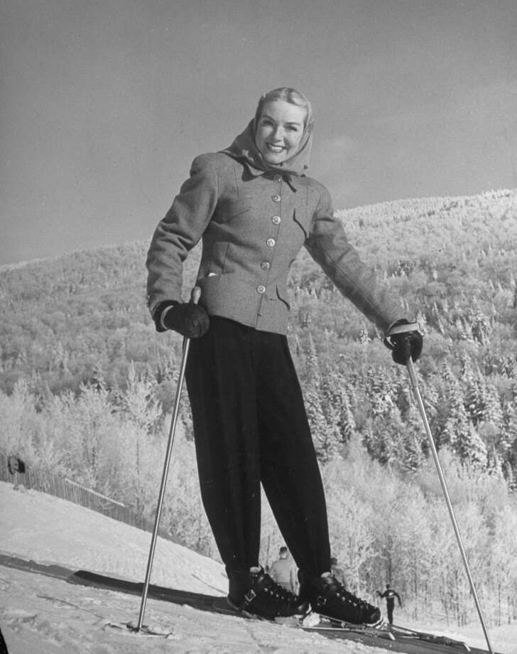 1944:  Ski Fashions: Model wearing gray tweed jacket and dark trousers on slopes at Mont Tremblant. Photo: Alfred Eisenstaedt, Time & Life Pictures/Getty Image