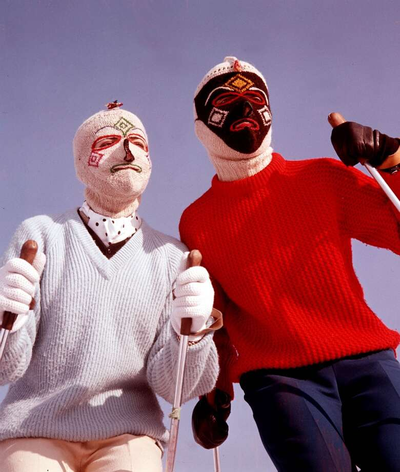 1960: Two skiers, in knitted, patterned balaclavas, wearing jumpers and holding ski-poles. Photo: Popperfoto, Popperfoto/Getty Images