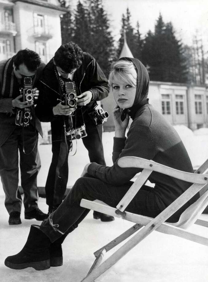 1961: French film star Brigitte Bardot sits in chair outside at a ski resort. Photo: Paul Popper/Popperfoto, Popperfoto/Getty Images