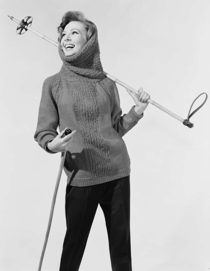 1962:  A ski sweater with a cowl neckline which is used as a hood. Photo: Chaloner Woods, Getty Images