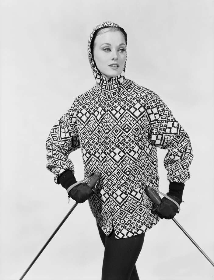 1963:  A woman modelling a hooded ski jacket.  ( Photo: Chaloner Woods, Getty Images