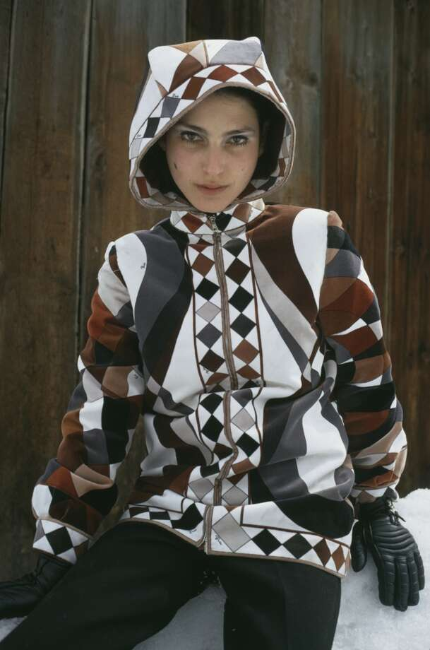 1969: A young woman modelling a hooded skiing jacket with a geometrical design. Photo: Ernst Haas, Getty Images