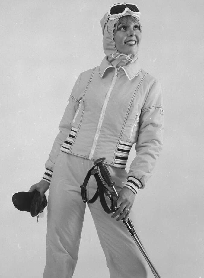 1973:  A young woman wearing a ski suit with a hood and a pair of goggles. Photo: Chaloner Woods, Getty Images