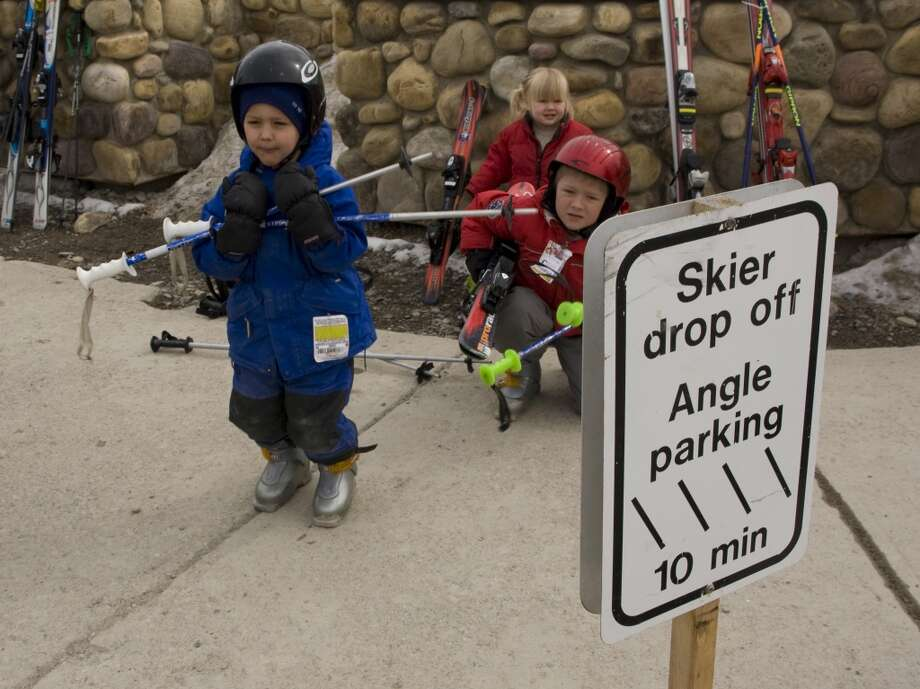 2010:  Kids wait to get picked up at Lake Louise Mountain Resort. Photo: George Rose, Getty Images