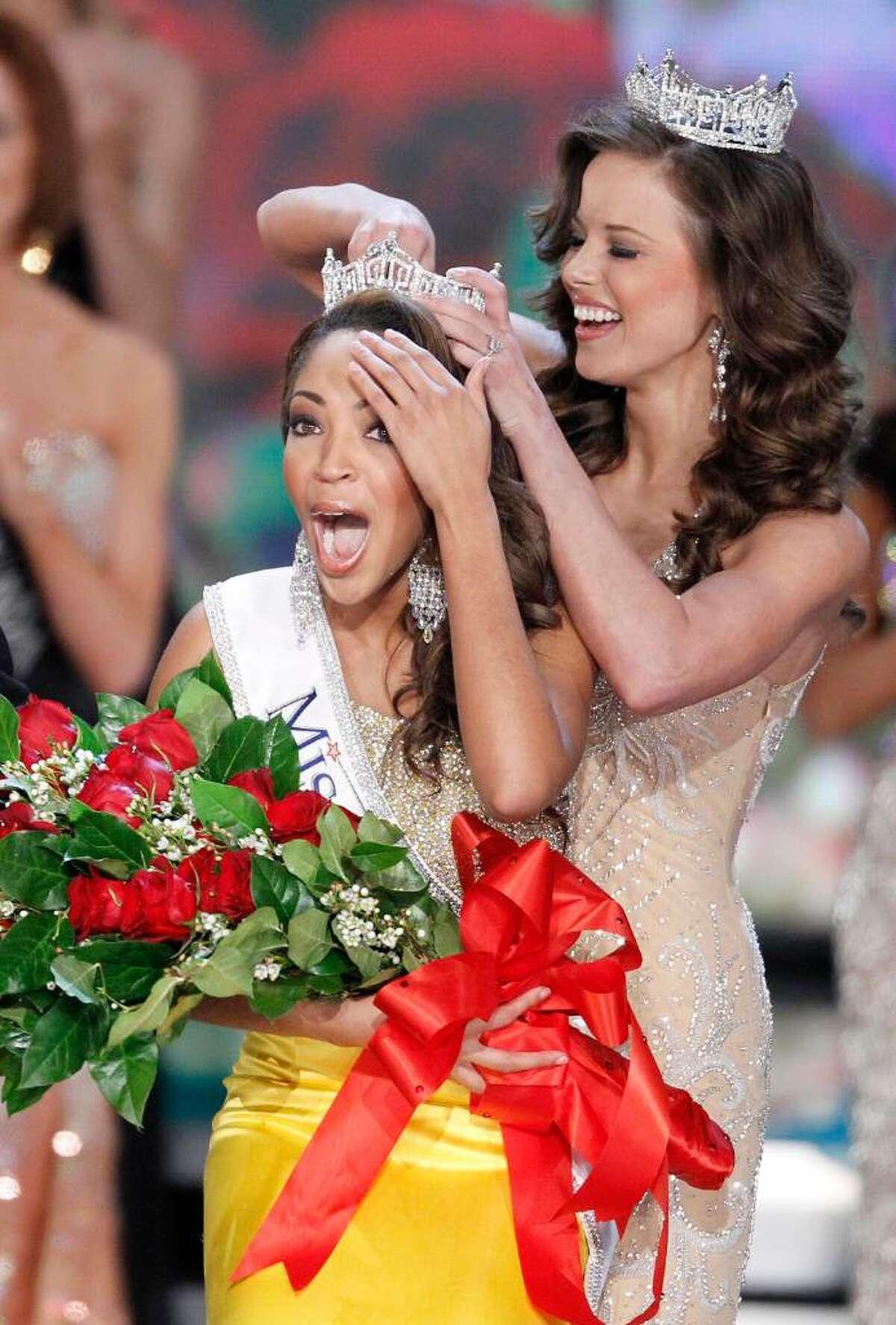 Miss Virginia Caressa Cameron reacts after being crowned Miss America by Katie Stam Miss America 2009, Saturday Jan. 30, 2010 in Las Vegas. (AP Photo/Eric Jamison)